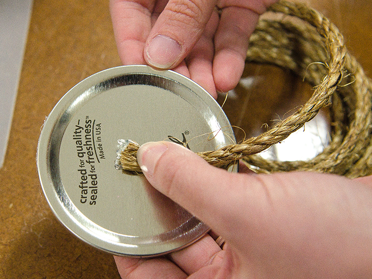 Glue the rope to the center of your canning lid.