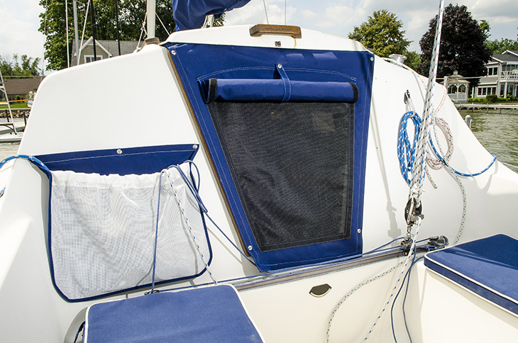 Cloth-to-surface snap fasteners installed on a boat.
