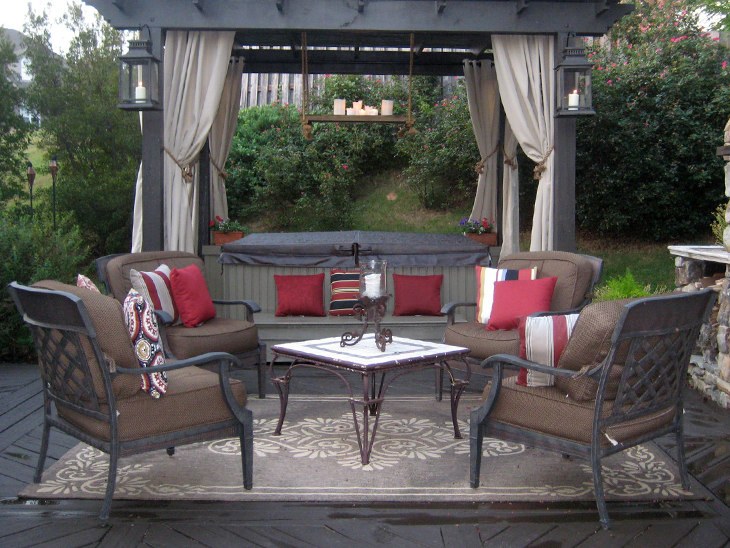 Amazing Beautiful Patio With Pergola With Curtains And Chairs Sitting Out In Front.