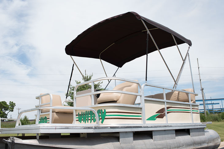 Completed 3-Bow Bimini top on a pontoon boat.