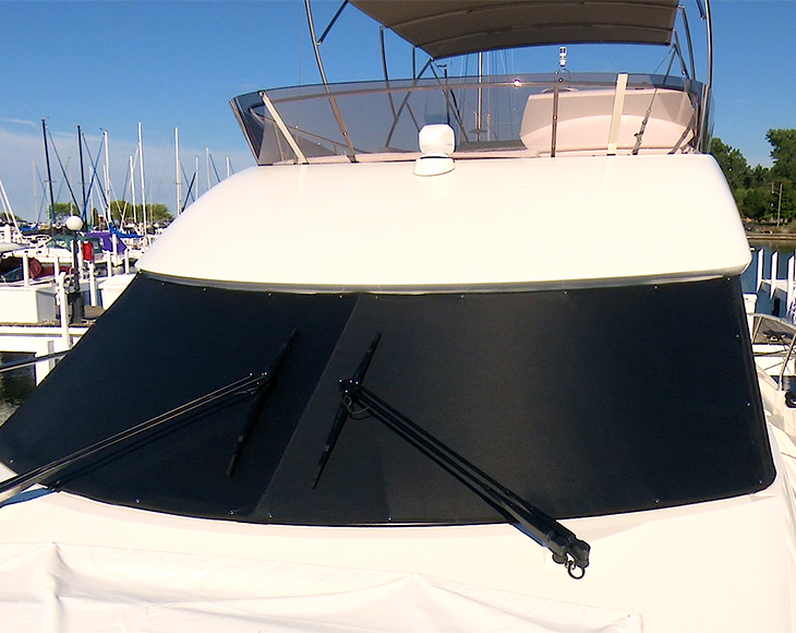 Sun shade installed on our boat's windshield.