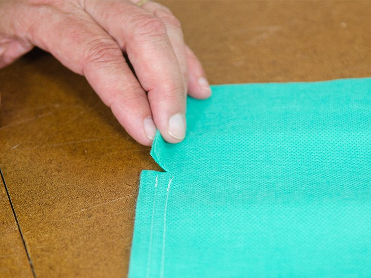 Widen the snip at the bag's opening to match the seam width.