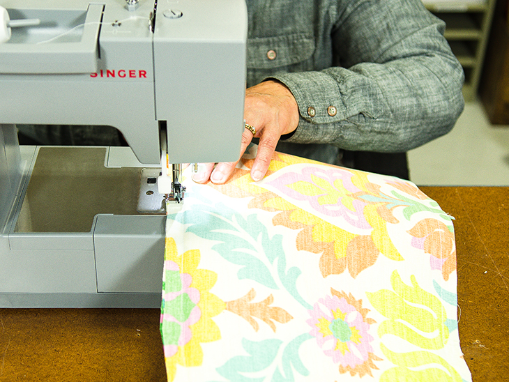Sew around the perimeter of the pillow, leaving an opening at the bottom to insert stuffing.
