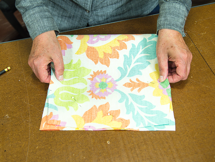 Fold over fabric. Use as a guide to trim the remaining two corners.
