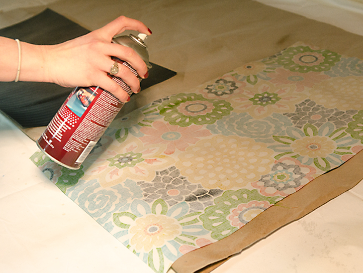 Apply spray adhesive to the top of the mat and the back of the fabric
