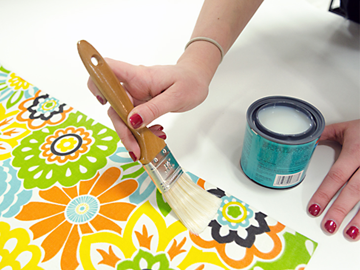 Paint a coat of polyurethane over the whole mat