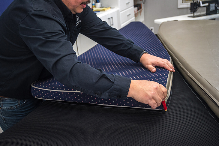 Using a cushion to trace a pattern on Moisture Prevention Underliner Fabric