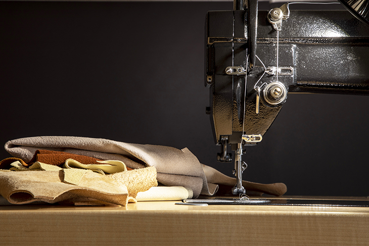 Sewing leather on an industrial machine.