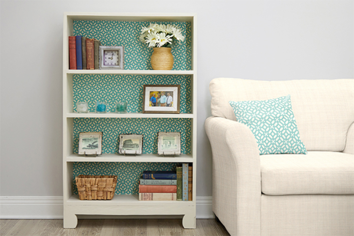 Enjoy your stylish revamped fabric-backed bookcase!